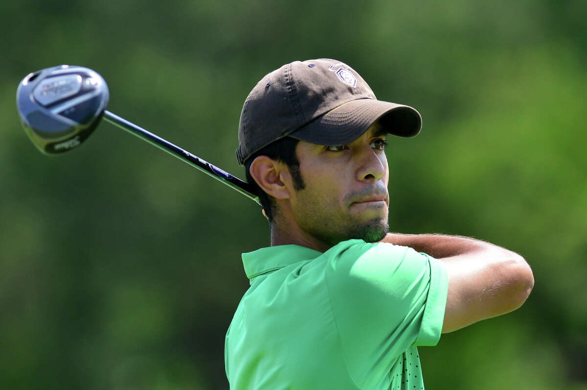 Arnold Martinez watches a tee shot during the 93rd Greater San Antonio Men's Championship at the Republic Golf Club Sunday afternoon.