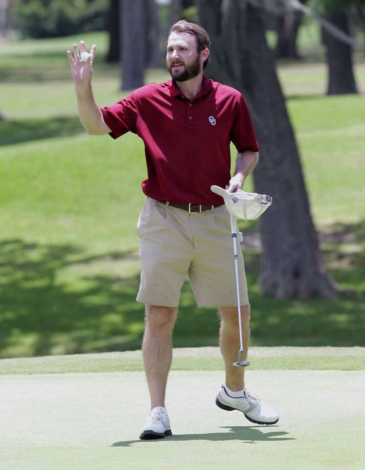Doug Manor of Austin, whose allegiances rest in Norman, Okla., puts the finishing touches on his three-stroke victory Sunday. Photo: James Nielsen, Staff / © 2013  Houston Chronicle