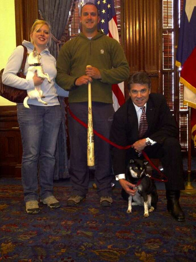 """Iraq War Vet Troy Yocum & wife Mareike w/Harley & Emmie"" Perry tweeted when he shared this picture with the web last year."