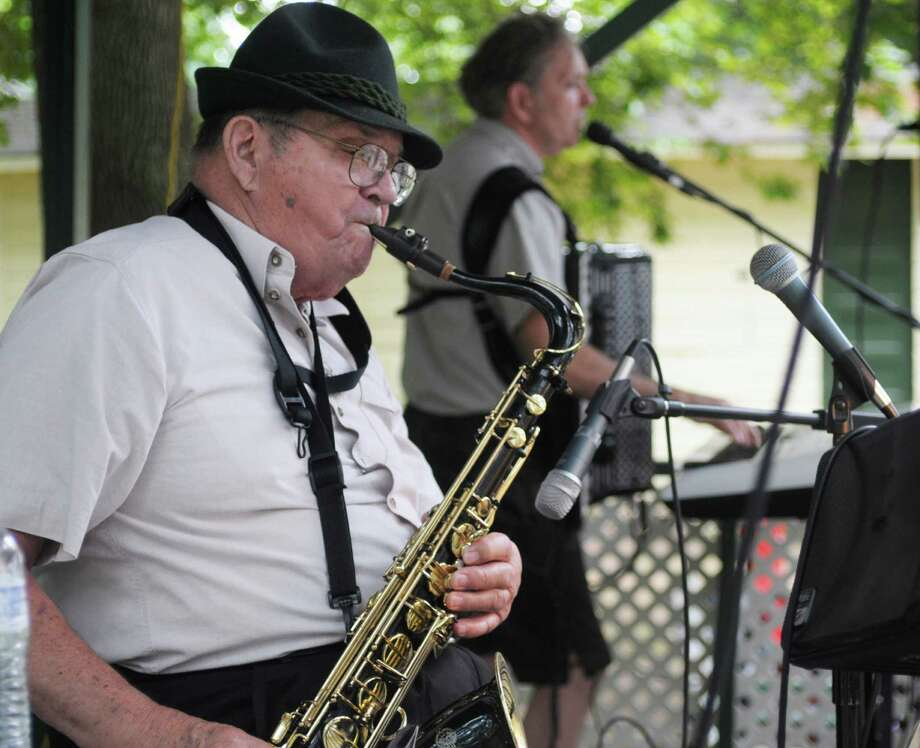 Karl Schwarzenegger, left, and his son, Arnold Richter, who make up the band the Schwarzennegger Connection perform at the First German-American Club Father's Day Picnic on Sunday, June 16, 2013 in Albany, NY.  Arnold says he has been playing music with his dad since he was 14 years old.  Karl has been playing the saxaphone for 72 years.   The club holds four picnics every year with their next picnic being the Old Time German Day Picnic on Sunday July 21, from 1-7 PM. (Paul Buckowski / Times Union) Photo: Paul Buckowski