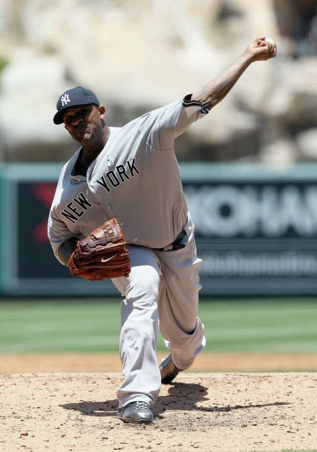 ANAHEIM, CA - JUNE 16:  CC Sabathia #52 of the New York Yankees pitches against the Los Angeles Angels of Anaheim in the third inning at Angel Stadium of Anaheim on June 16, 2013 in Anaheim, California.  (Photo by Jeff Gross/Getty Images) Photo: Jeff Gross