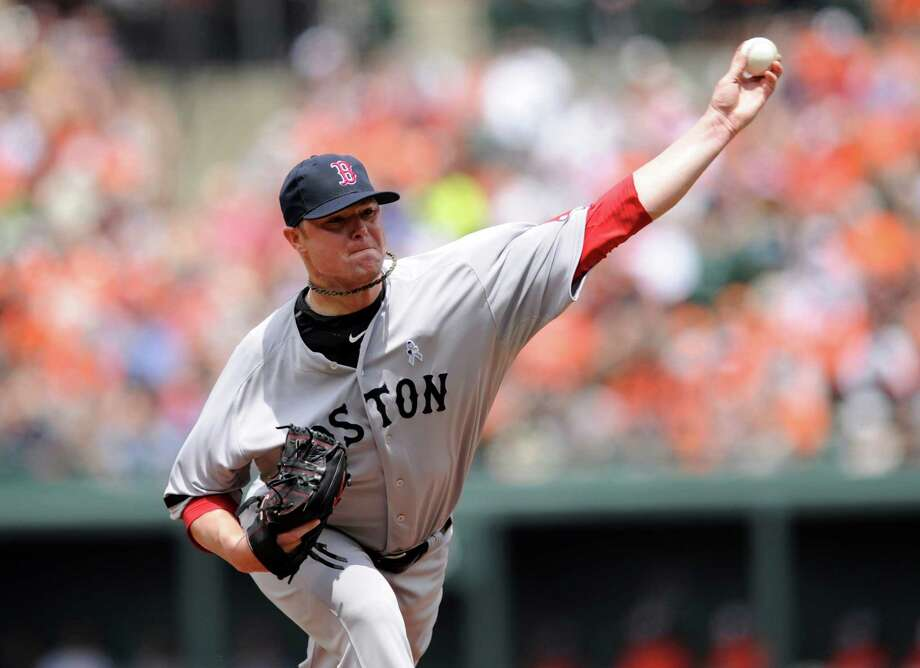 Boston Red Sox starting pitcher Jon Lester delivers against the Baltimore Orioles during the first inning of a baseball game on Sunday, June 16, 2013, in Baltimore. (AP Photo/Nick Wass) Photo: Nick Wass