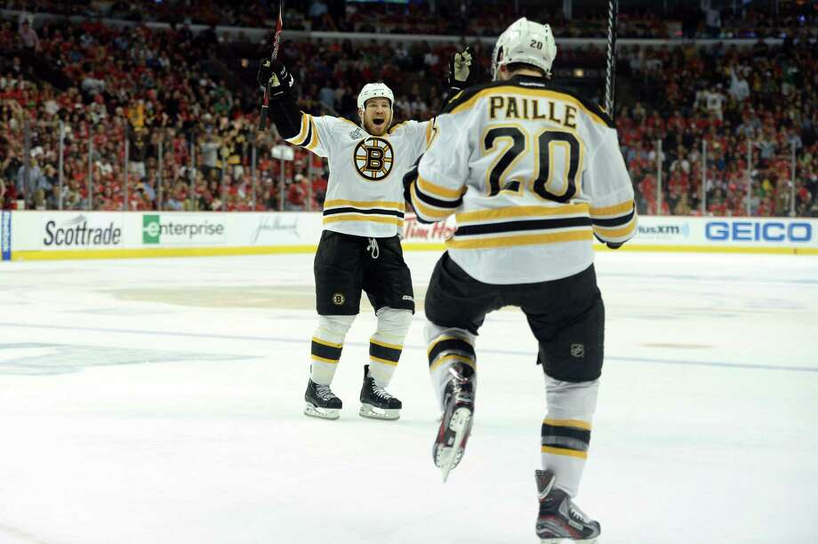 CHICAGO, IL - JUNE 15:  (L-R) Daniel Paille #20 and Andrew Ference #21 of the Boston Bruins celebrate after Paille scored the game-winning goal in overtime to win 2-1 against the Chicago Blackhawks in Game Two of the NHL 2013 Stanley Cup Final at United Center on June 15, 2013 in Chicago, Illinois.  (Photo by Harry How/Getty Images) Photo: Harry How