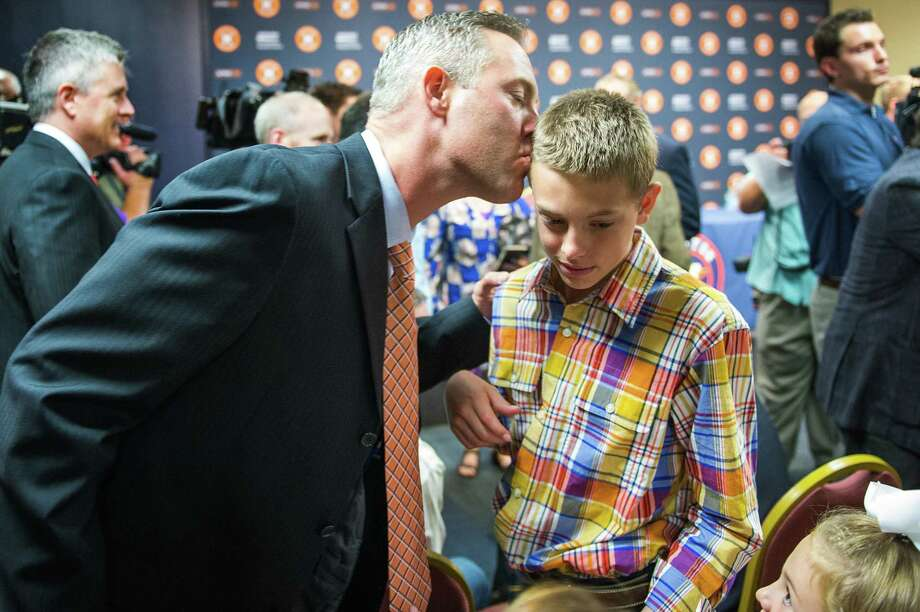 Reid Ryan greets son Jackson, 13, after becoming the Astros' president in May. Jackson was born with cerebral palsy. Photo: Smiley N. Pool / Houston Chronicle