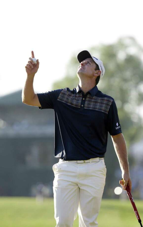 Justin Rose of England honors his father Ken, who died from leukemia in 2002, after a putt on the 18th hole to close out his first U.S. Open title with a 70. Rose beat Jason Day and Phil Mickelson by two shots. Photo: Morry Gash / Associated Press
