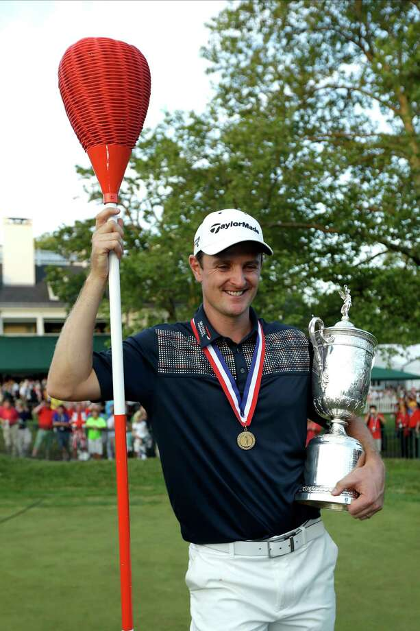 Justin Rose, of England, poses with the trophy after winning the U.S. Open golf tournament at Merion Golf Club, Sunday, June 16, 2013, in Ardmore, Pa. (AP Photo/Julio Cortez) Photo: Julio Cortez