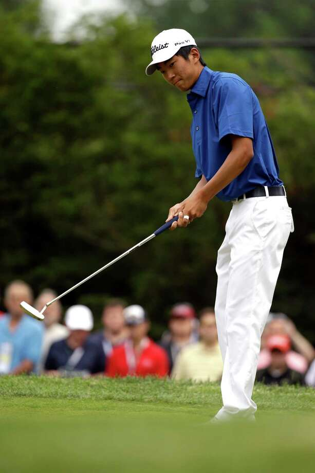 Michael Kim reacts to a missed putt on the first hole during the fourth round of the U.S. Open golf tournament at Merion Golf Club, Sunday, June 16, 2013, in Ardmore, Pa. (AP Photo/Morry Gash) Photo: Morry Gash
