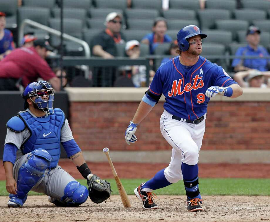 NEW YORK, NY - JUNE 16:  Kirk Nieuwenhuis #9 of the New York Mets connects on a three-run home run against the Chicago Cubs in the ninth inning during their game on June 16, 2013 at Citi Field in the Flushing neighborhood of the Queens borough of New York City. (Photo by Jason Szenes/Getty Images) Photo: Jason Szenes
