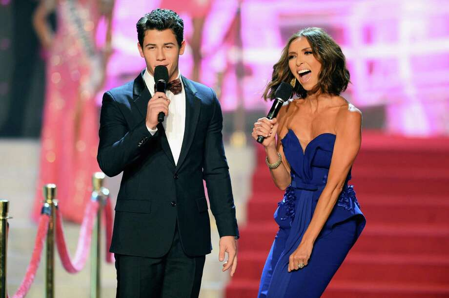Recording artist and host Nick Jonas (L) and television personality and host Giuliana Rancic (R) speak onstage during the 2013 Miss USA pageant at PH Live at Planet Hollywood Resort & Casino on June 16, 2013 in Las Vegas. Photo: Ethan Miller, Getty Images / 2013 Getty Images