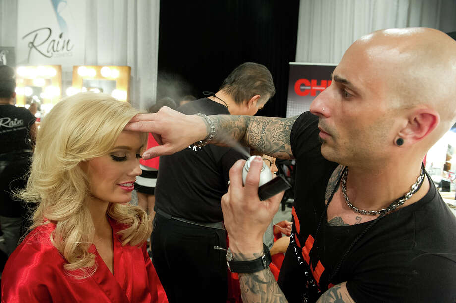 Miss Indiana USA 2013, Emily Hart, gets her hair done by a Chi Artist before the 2013 MISS USA Competition at PH Live in Las Vegas, Nevada on Sunday June 16, 2013. Photo: Darren Decker, Miss Universe Organization / Miss Universe Organization L.P., LLLP.
