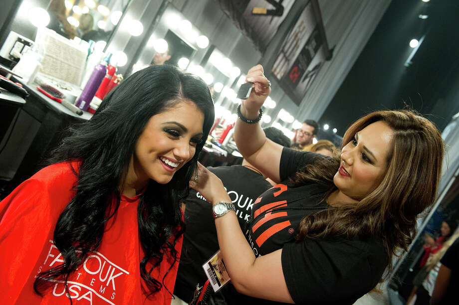 Miss Oregon USA 2013, Gabrielle Neilan, gets her hair done by a Chi Artist before the 2013 MISS USA Competition at PH Live in Las Vegas, Nevada on Sunday June 16, 2013. Photo: Darren Decker, Miss Universe Organization / Miss Universe Organization L.P., LLLP.