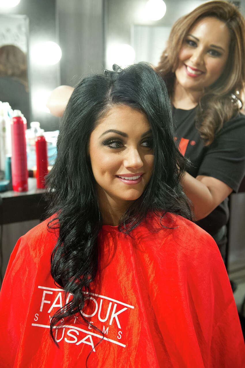 Miss Oregon USA 2013, Gabrielle Neilan, gets her hair done by a Chi Artist before the 2013 MISS USA Competition at PH Live in Las Vegas, Nevada on Sunday June 16, 2013. HO/Miss Universe Organization L.P., LLLP.