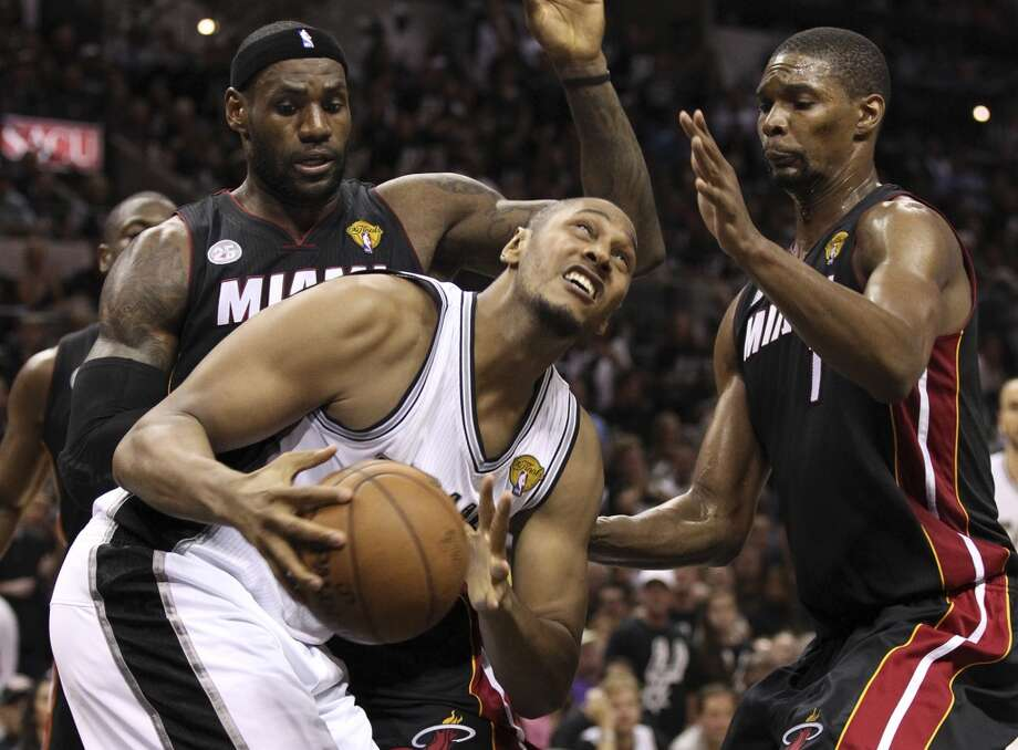 San Antonio Spurs' Boris Diaw looks to shoot while under pressure from Miami Heat's LeBron James and Chris Bosh during the second half of Game 5 of the NBA Finals at the AT&T Center on Sunday, June 16, 2013. (Kin Man Hui/San Antonio Express-News)