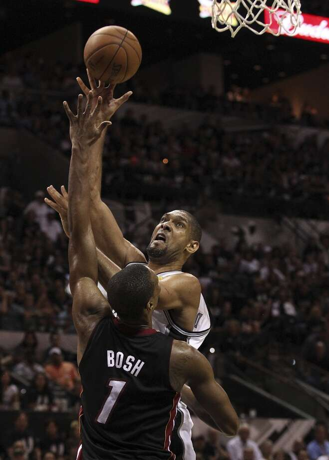 San Antonio Spurs' Tim Duncan goes up for a shot against Miami Heat's Chris Bosh during the second half of Game 5 of the NBA Finals at the AT&T Center on Sunday, June 16, 2013. (Kin Man Hui/San Antonio Express-News)