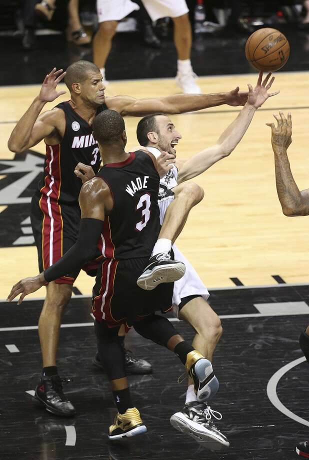 San Antonio Spurs' Manu Ginobili is fouled by Miami Heat's Dwyane Wade during the fist half of Game 5 of the NBA Finals at the AT&T Center on Sunday, June 16, 2013. (Jerry Lara/San Antonio Express-News)