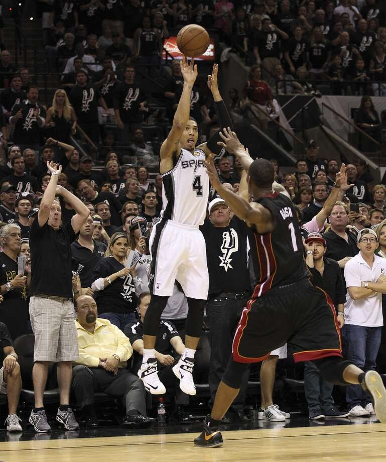 San Antonio Spurs' Danny Green lines up a three-pointer against Miami Heat's Chris Bosh during the second half of Game 5 of the NBA Finals at the AT&T Center on Sunday, June 16, 2013. (Kin Man Hui/San Antonio Express-News)