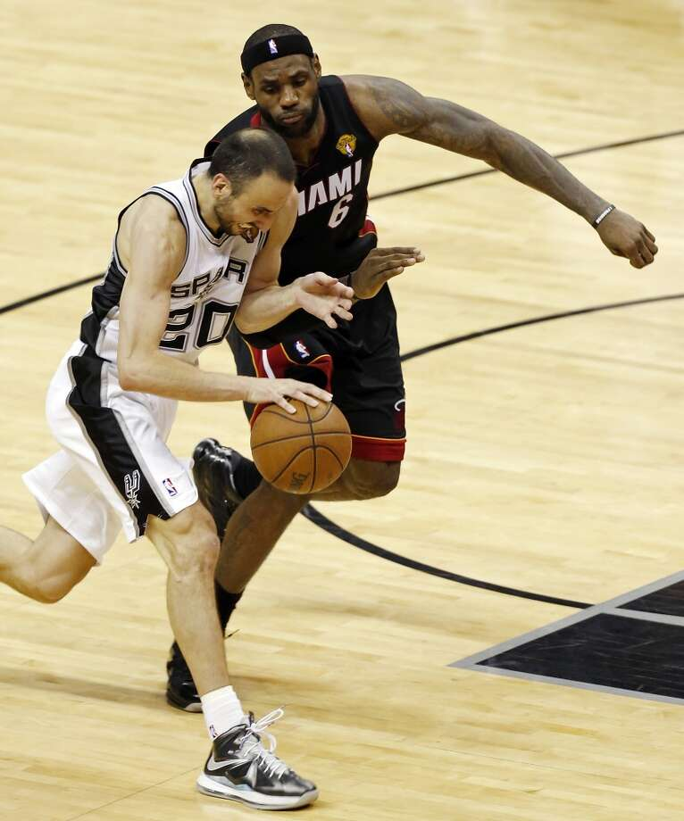 San Antonio Spurs' Manu Ginobili looks for room around Miami Heat's LeBron James during second half action in Game 5 of the 2013 NBA Finals Sunday June 16, 2013 at the AT&T Center. (Edward A. Ornelas/San Antonio Express-News)