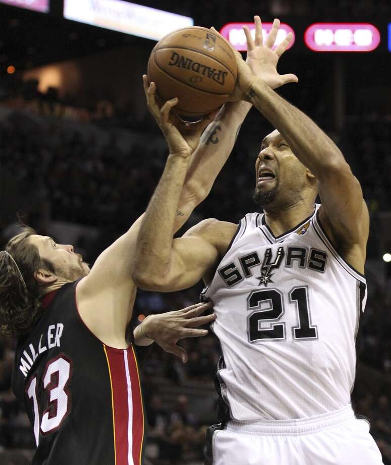 San Antonio Spurs' Tim Duncan shoots over Miami Heat's Mike Miller during the first half of Game 5 of the NBA Finals at the AT&T Center on Sunday, June 16, 2013. (Kin Man Hui/San Antonio Express-News)