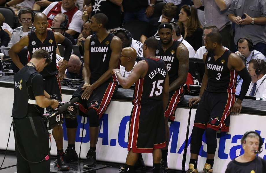 The Miami Heat sit on the scorer's table during second half action in Game 5 of the 2013 NBA Finals Sunday June 16, 2013 at the AT&T Center. (Edward A. Ornelas/San Antonio Express-News)