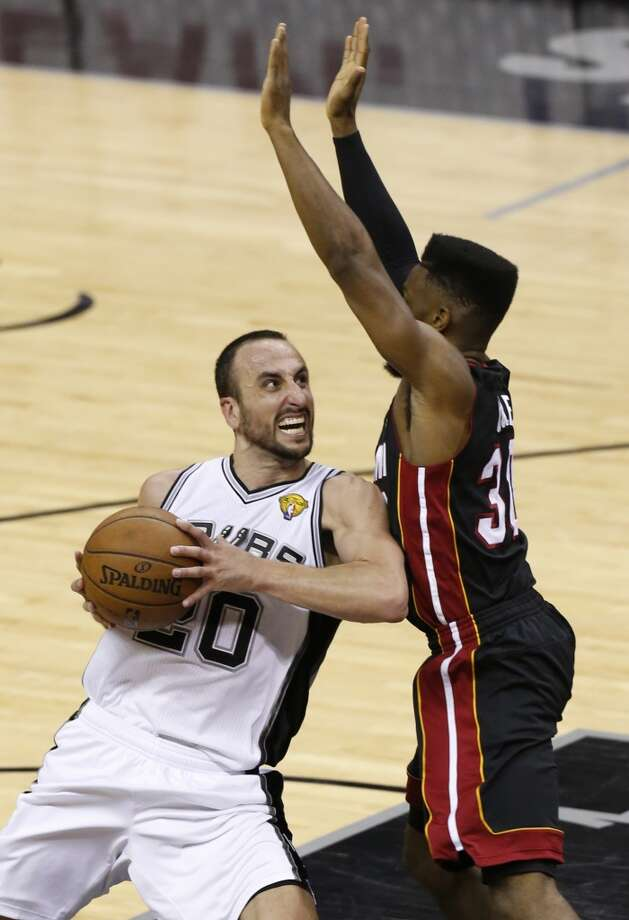 San Antonio Spurs' Manu Ginobili tries to shoot over Miami Heat's Norris Cole during second half action in Game 5 of the 2013 NBA Finals Sunday June 16, 2013 at the AT&T Center. (Edward A. Ornelas/San Antonio Express-News)