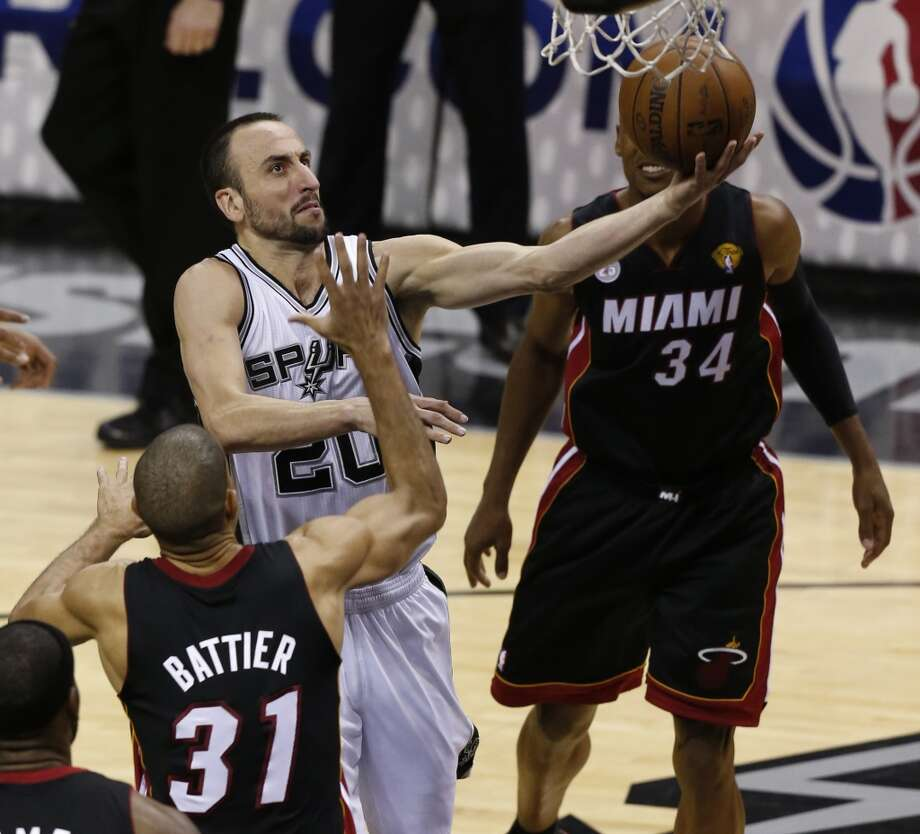 San Antonio Spurs' Manu Ginobili drives past Miami Heat's Shane Battier during the during second half action in Game 5 of the 2013 NBA Finals Sunday June 16, 2013 at the AT&T Center. (Edward A. Ornelas/San Antonio Express-News)