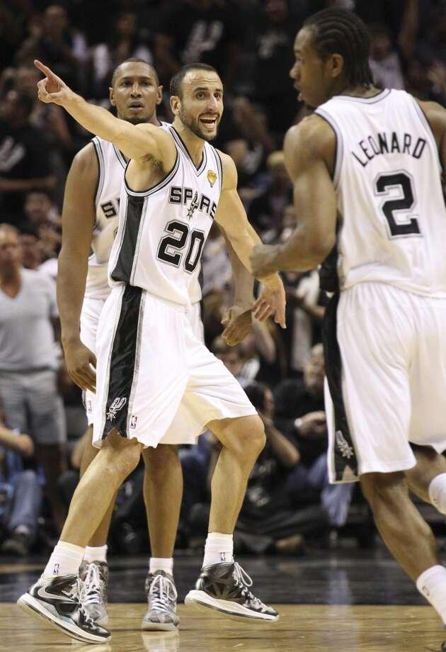 San Antonio Spurs' Manu Ginobili calls directions to Kawhi Leonard during the first half of Game 5 of the NBA Finals at the AT&T Center on Sunday, June 16, 2013. (Kin Man Hui/San Antonio Express-News)