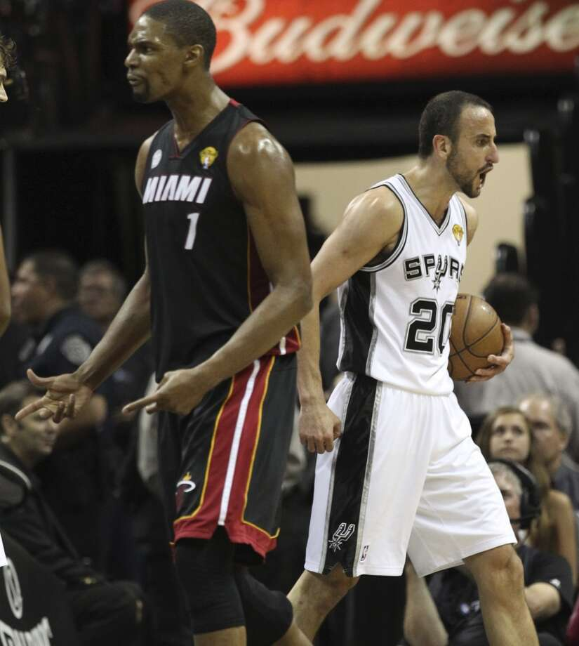 San Antonio Spurs' Manu Ginobili and Miami Heat's Chris Bosh react to a call during the first half of Game 5 of the NBA Finals at the AT&T Center on Sunday, June 16, 2013. (Kin Man Hui/San Antonio Express-News)