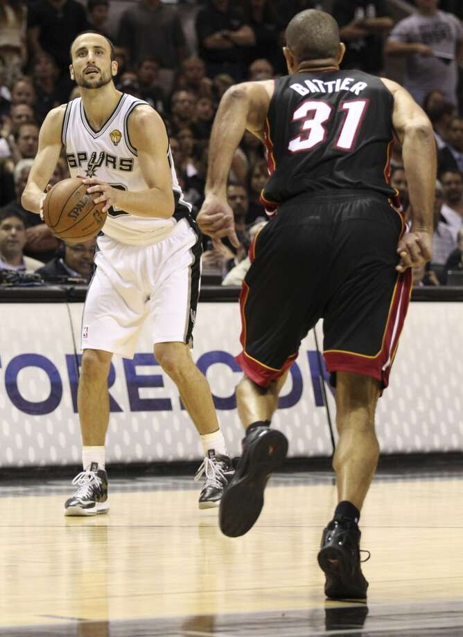 San Antonio Spurs' Manu Ginobili shoots for three points while Miami Heat's Shane Battier defends against him during the first half of Game 5 of the NBA Finals at the AT&T Center on Sunday, June 16, 2013. (Kin Man Hui/San Antonio Express-News)