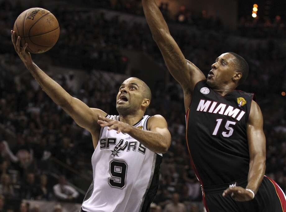 San Antonio Spurs' Tony Parker drives past Miami Heat's Mario Chalmers on his way to the hoop during the second half of Game 5 of the NBA Finals at the AT&T Center on Sunday, June 16, 2013. (Kin Man Hui/San Antonio Express-News)