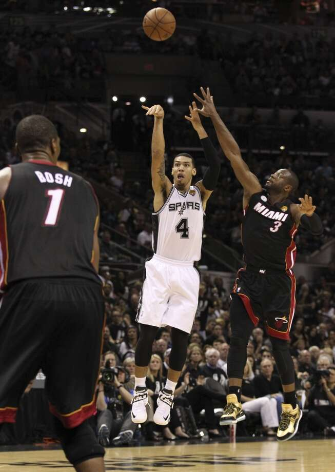 San Antonio Spurs' Danny Green shoots a three point shot while under pressure from Miami Heat's Dwyane Wade during the second half of Game 5 of the NBA Finals at the AT&T Center on Sunday, June 16, 2013. (Kin Man Hui/San Antonio Express-News)