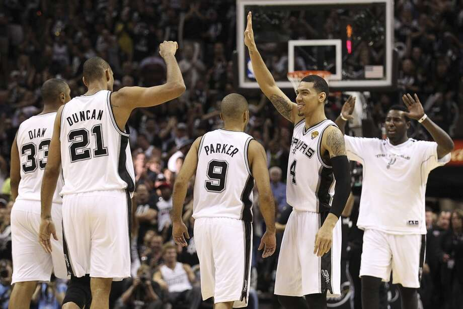 San Antonio Spurs' Danny Green smiles while waiting to high-five San Antonio Spurs' Tim Duncan after a timeout by the Miami Heat during the second half of Game 5 of the NBA Finals at the AT&T Center on Sunday, June 16, 2013. (Kin Man Hui/San Antonio Express-News)