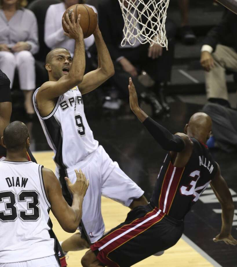 San Antonio Spurs' Tony Parker shoots over Miami Heat's Ray Allen during the fist half of Game 5 of the NBA Finals at the AT&T Center on Sunday, June 16, 2013. (Jerry Lara/San Antonio Express-News)