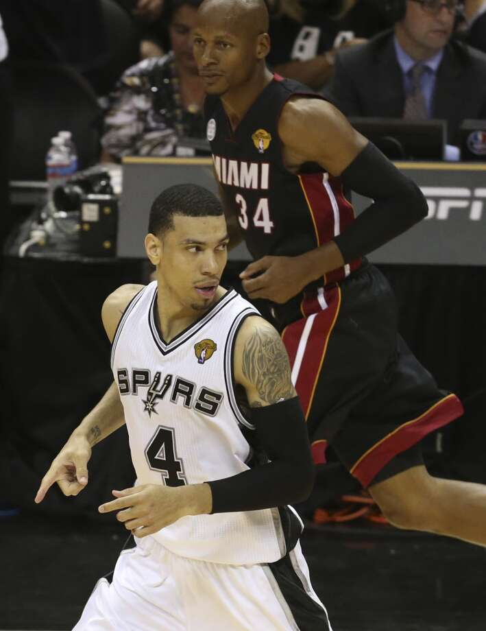 San Antonio Spurs' Danny Green runs up court with Miami Heat's Ray Allen following him during the fist half of Game 5 of the NBA Finals at the AT&T Center on Sunday, June 16, 2013. (Jerry Lara/San Antonio Express-News)