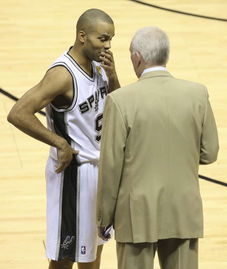 San Antonio Spurs' Tony Parker talks to San Antonio Spurs head coach Gregg Popovich during the fist half of Game 5 of the NBA Finals at the AT&T Center on Sunday, June 16, 2013. (Jerry Lara/San Antonio Express-News)