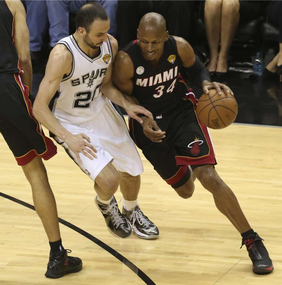 San Antonio Spurs' Manu Ginobili defends against Miami Heat's Ray Allen during the fist half of Game 5 of the NBA Finals at the AT&T Center on Sunday, June 16, 2013. (Jerry Lara/San Antonio Express-News)