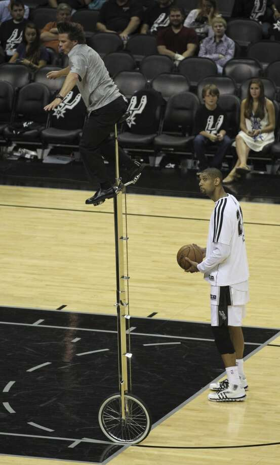 San Antonio Spurs' Tim Duncan reacts to one of the entertainers as Duncan tries to shoot practice free-throws before the start of the second half of Game 5 of the NBA Finals at the AT&T Center on Sunday, June 16, 2013. (Jerry Lara/San Antonio Express-News)