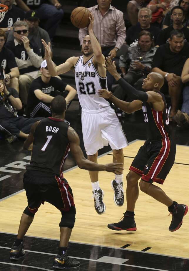 San Antonio Spurs' Manu Ginobili shoots between Miami Heat's Chris Bosh, left, and Ray Allen during the second half of Game 5 of the NBA Finals at the AT&T Center on Sunday, June 16, 2013. (Jerry Lara/San Antonio Express-News)