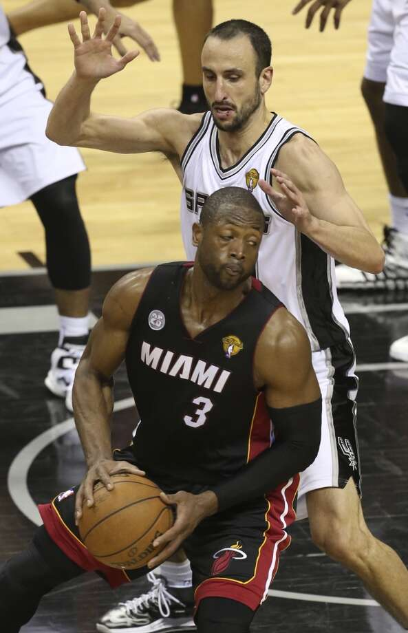San Antonio Spurs' Manu Ginobili defends against Miami Heat's Dwyane Wade during the second half of Game 5 of the NBA Finals at the AT&T Center on Sunday, June 16, 2013. (Jerry Lara/San Antonio Express-News)