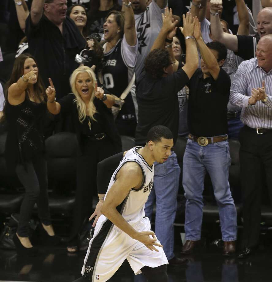 Spurs fans react after San Antonio Spurs' Danny Green scored his last three point shot during the second half of Game 5 of the NBA Finals at the AT&T Center on Sunday, June 16, 2013. (Jerry Lara/San Antonio Express-News)