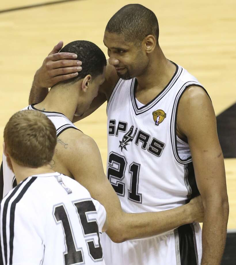 San Antonio Spurs' Tim Duncan hugs Danny Green after Green scored his last record-setting three point shot during the second half of the Spurs 114-104 win over the Miami Heat during Game 5 of the NBA Finals at the AT&T Center on Sunday, June 16, 2013. (Jerry Lara/San Antonio Express-News)