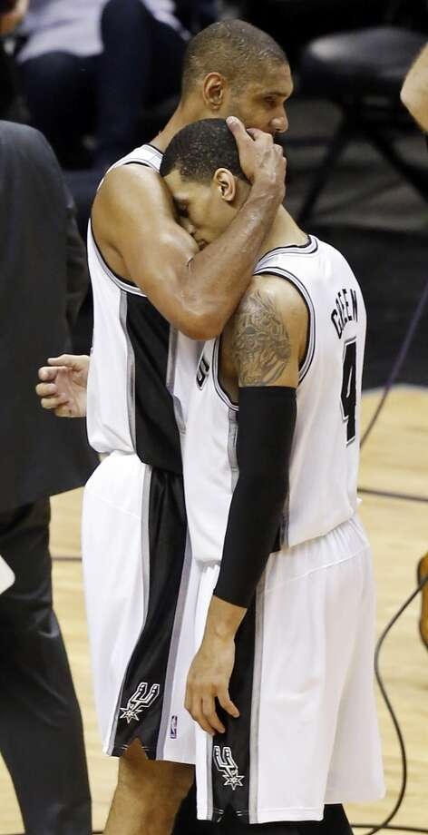 San Antonio Spurs' Tim Duncan and San Antonio Spurs' Danny Green hug after Green hit a 3-pointer during second half action in Game 5 of the 2013 NBA Finals against the Miami Heat Sunday June 16, 2013 at the AT&T Center. The Spurs won 114-104. (Edward A. Ornelas/San Antonio Express-News)