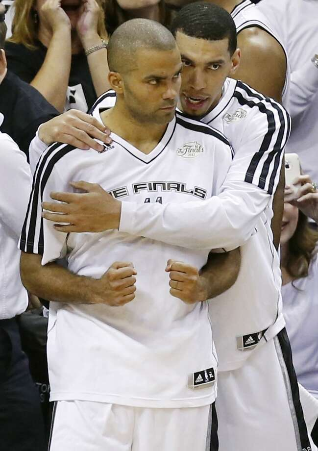San Antonio Spurs' Tony Parker and San Antonio Spurs' Danny Green celebrate after Game 5 of the 2013 NBA Finals against the Miami Heat Sunday June 16, 2013 at the AT&T Center. The Spurs won 114-104. (Edward A. Ornelas/San Antonio Express-News)