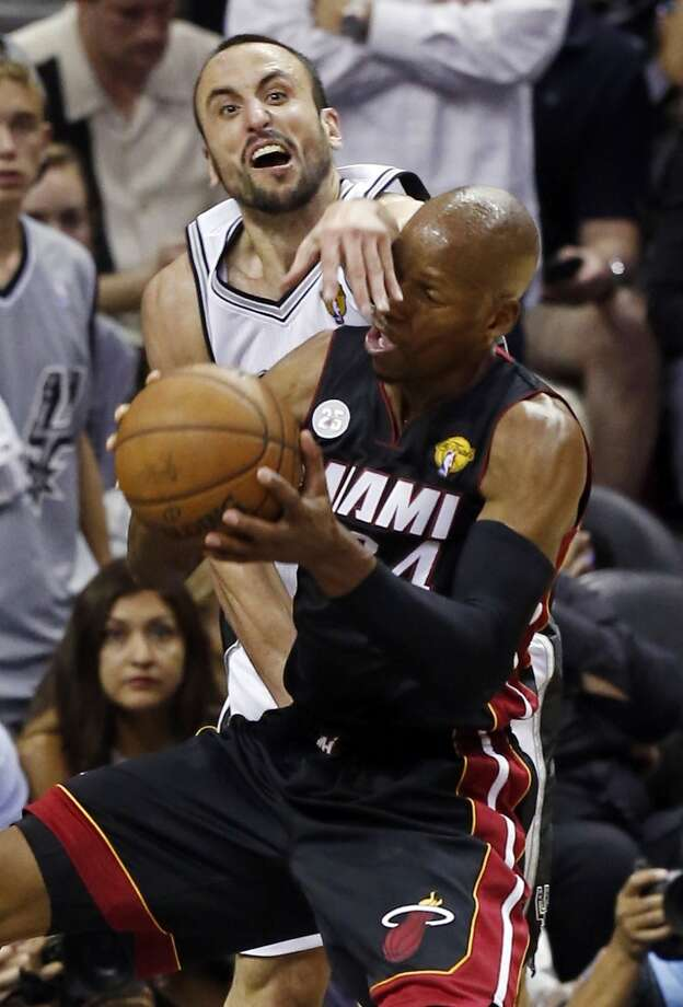 San Antonio Spurs' Manu Ginobili defends Miami Heat's Ray Allenduring second half action in Game 5 of the 2013 NBA Finals Sunday June 16, 2013 at the AT&T Center. (Edward A. Ornelas/San Antonio Express-News)