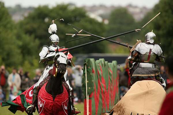 Re-enactors dressed as knights stage a medieval jousting competition at Eltham Palace on June 16, 2013 in Eltham, England. The 'Grand Medieval Joust' event at Eltham Palace, an English Heritage property which was the childhood home of King Henry VIII, aims to give an great insight into life at the palace during the medieval period.