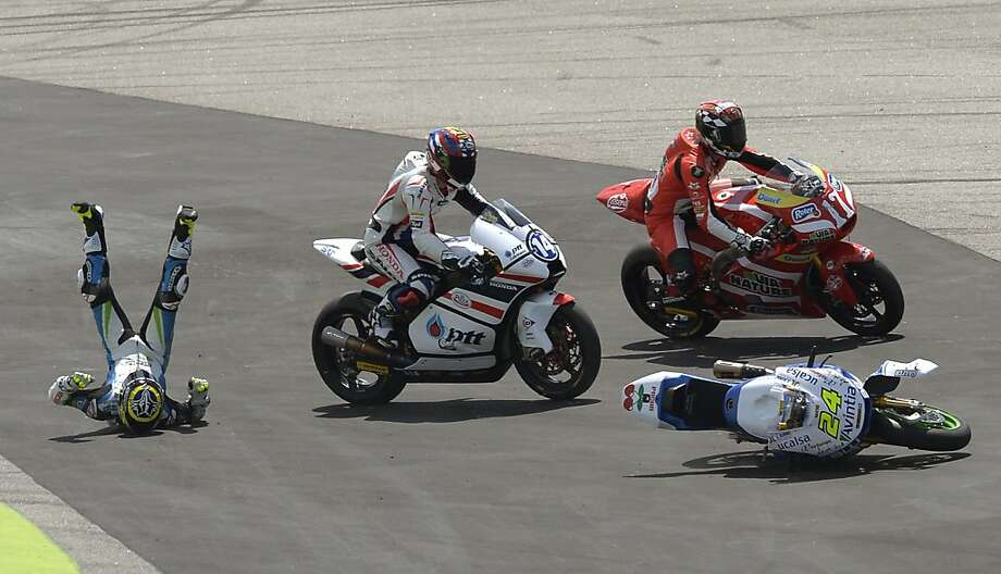 Moto2 rider Tony Elias from Spain crashes during the Motorcycling Grand Prix race at the Montmelo racetrack near Barcelona, Spain, Sunday, June 16, 2013.  (AP Photo/Manu Fernandez) Photo: Manu Fernandez, Associated Press
