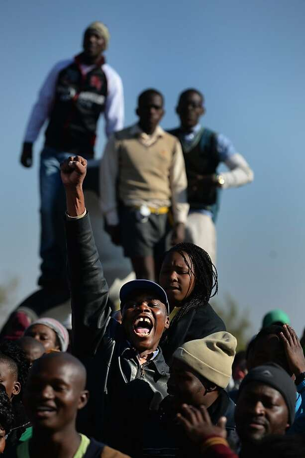 JOHANNESBURG, SOUTH AFRICA - JUNE 16:  People participate in a march to commemorate Youth Day in Soweto Township on June 16, 2013 in Johannesburg, South Africa. Youth Day commemorates the Soweto Uprising of June 16, 1976, when students gathered on the streets of Soweto to protest against Afrikaans being the language of instruction used in schools. The protest turned violent resulting in the deaths of students and hundreds in the riots that followed across South Africa..  (Photo by Jeff J Mitchell/Getty Images) *** BESTPIX *** Photo: Jeff J Mitchell, Getty Images