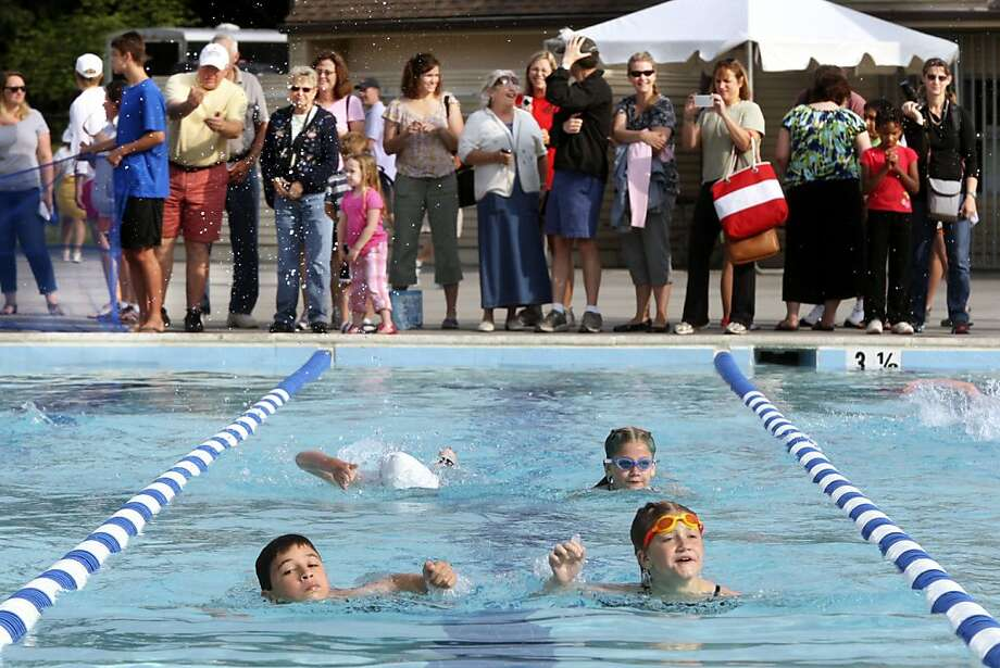 Parents watch as childern compete Sunday June 16, 2013 in the swimming section of the Sherando Park Youth Triathlon in Stephens City, Va.  (AP Photo/The Winchester Star, Scott Mason) Photo: Scott Mason, Associated Press