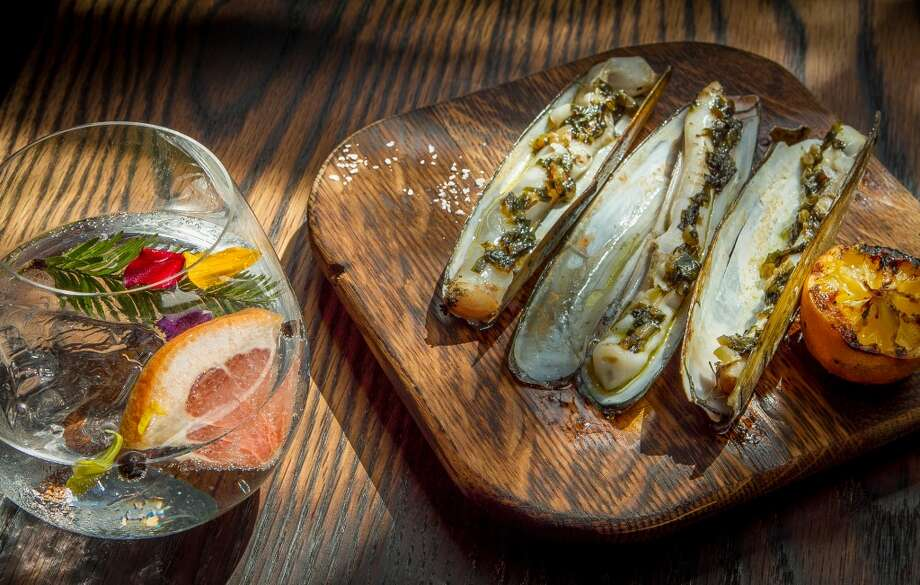 The grilled Razor Clams with the Barca Gintonic at Coqueta in San Francisco, Calif., are seen on Monday,  June 10th, 2013.