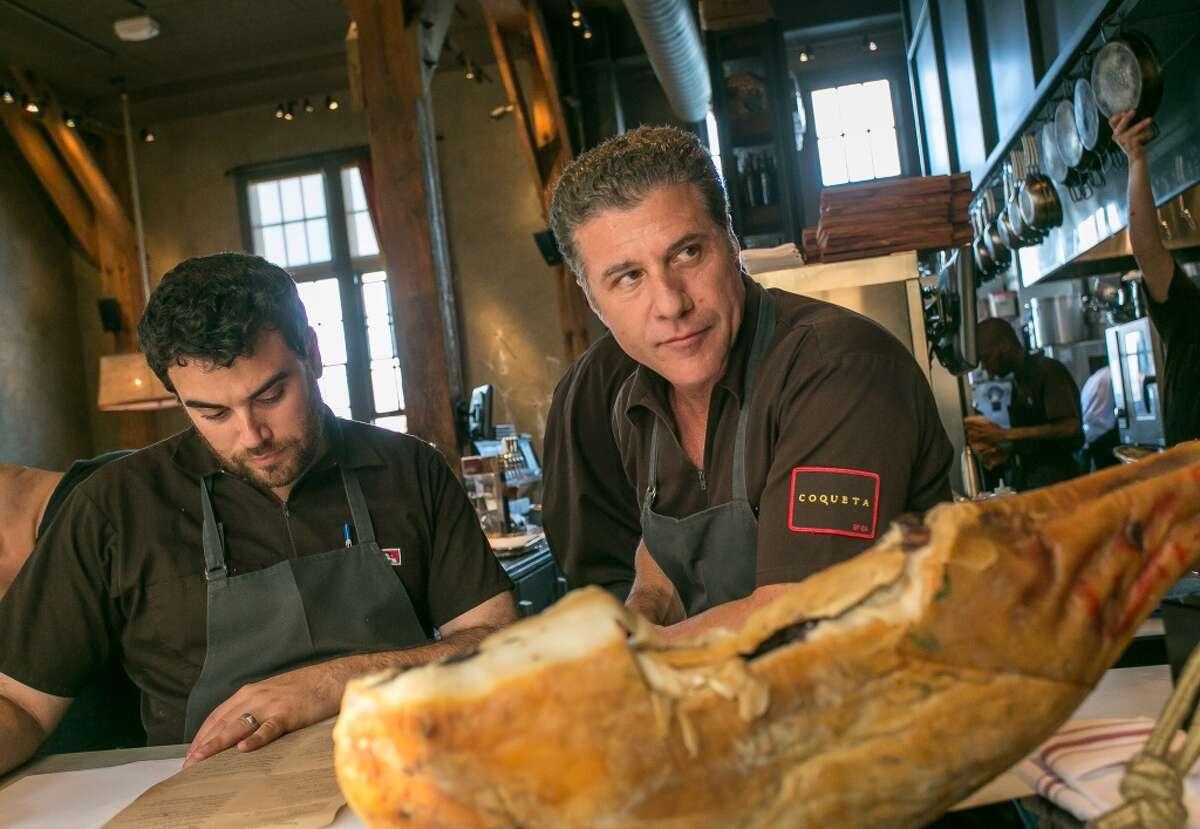 Chef Michael Chiarello talks with Chef de Cuisine Ryan McIlwraith at Coqueta.