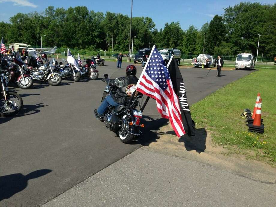 The Patriot Guard riders gather at Albany International Airport on Monday to escort the body of Lt. Col. Todd Clark to Christian Brothers Academy where calling hours will be held on Monday afternoon. (Skip Dickstein / Times Union)